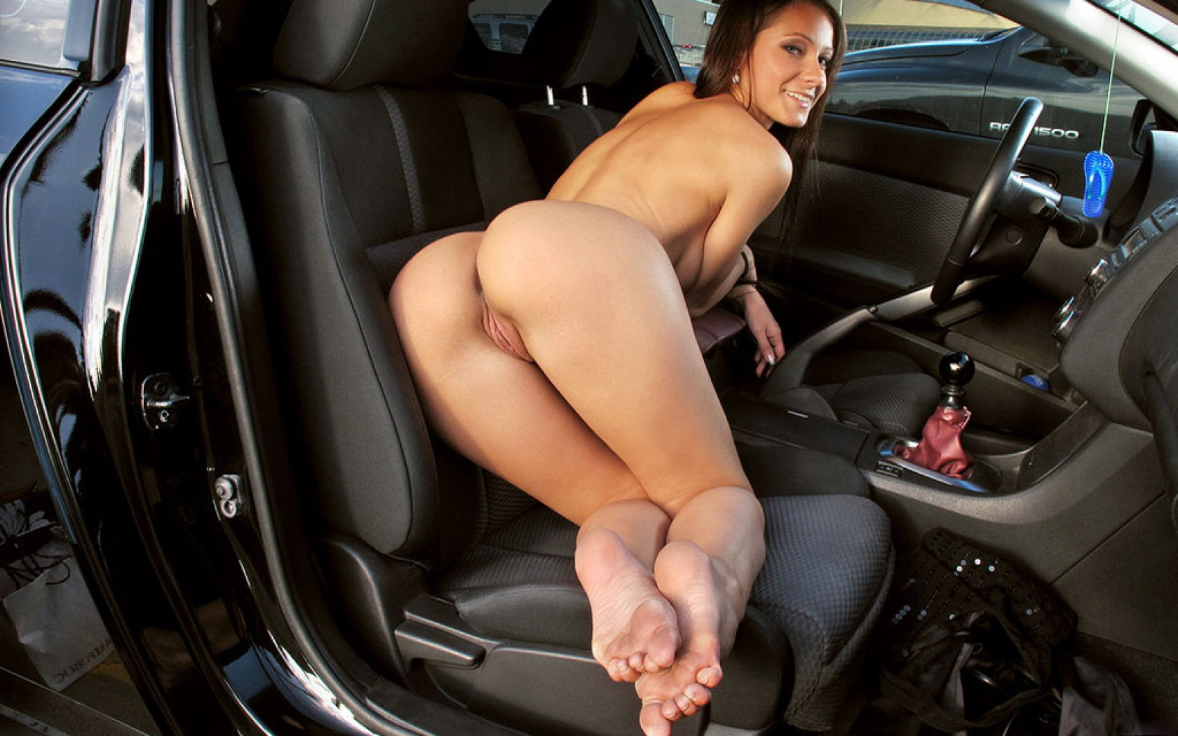 Naked young girl with car can
