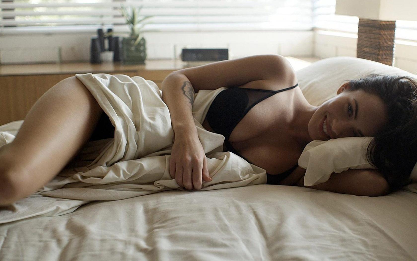 Wallpaper brunette lingerie bed smile tatoo megan fox for Hot bedroom photos