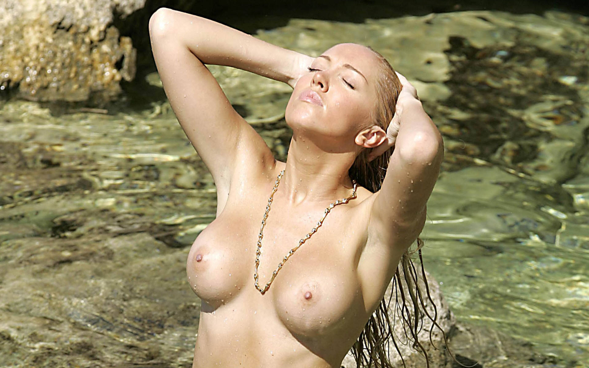 A wet girl getting naked