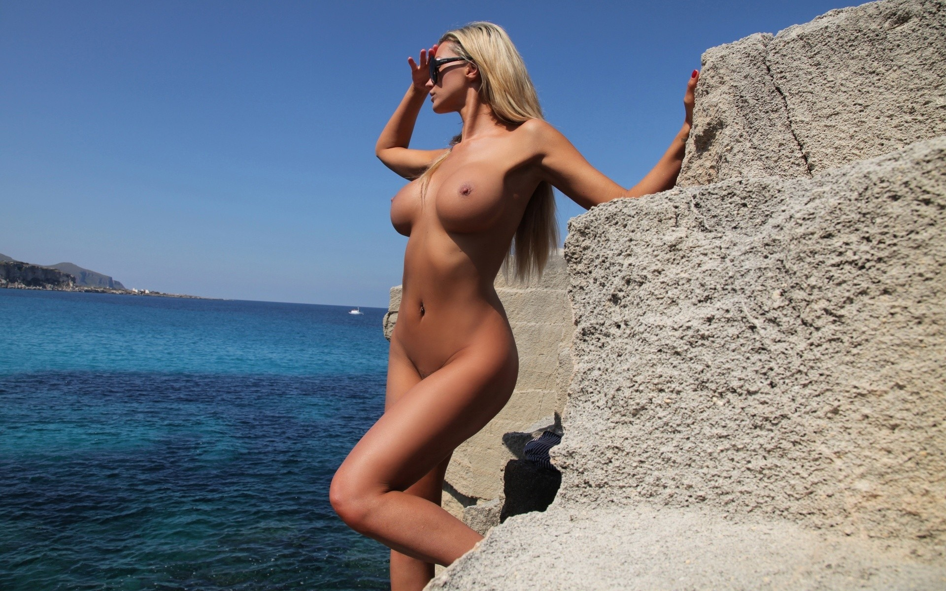 Question Naked women with huge tits on beach