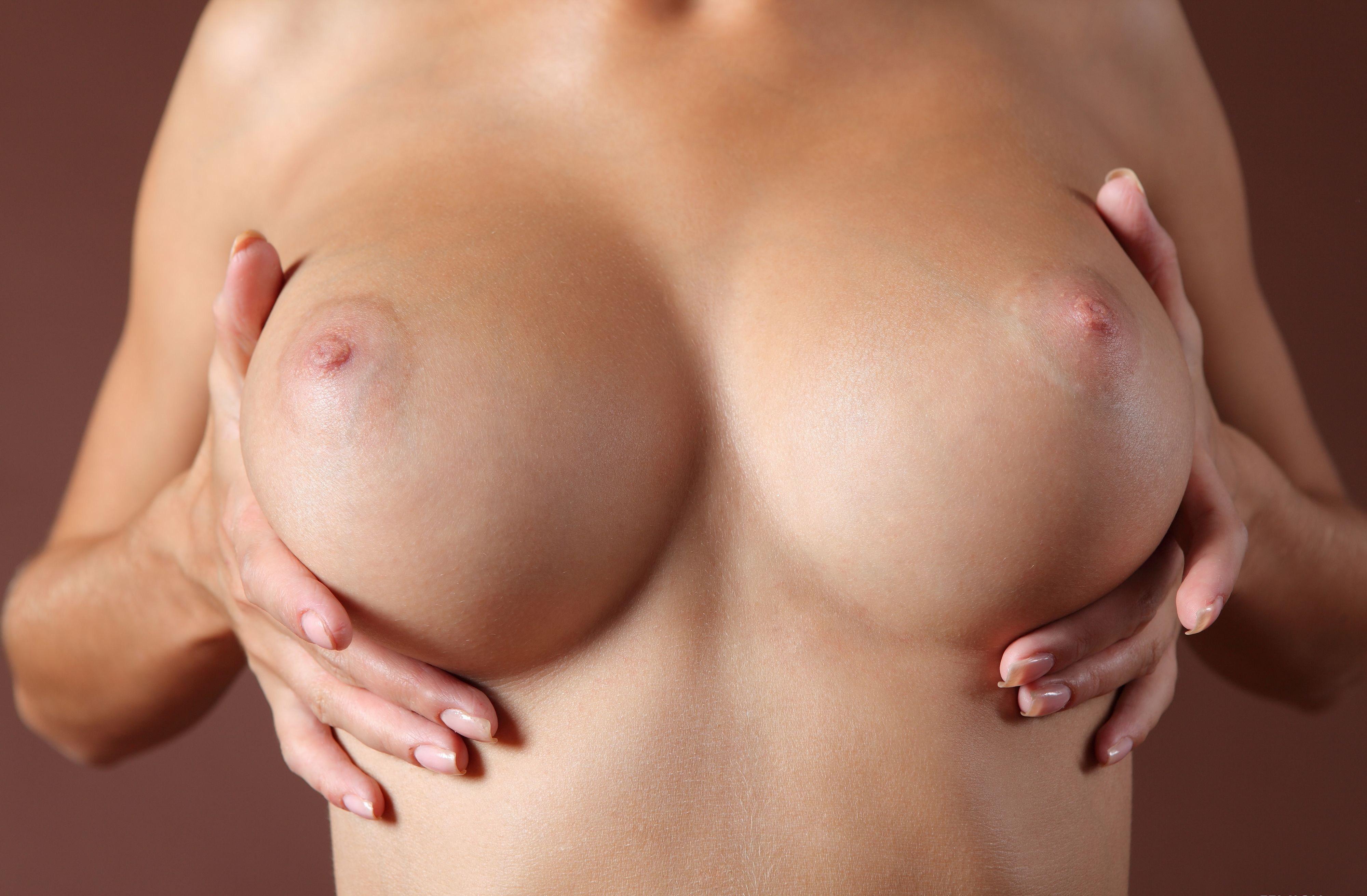 squeezing breast nude pics