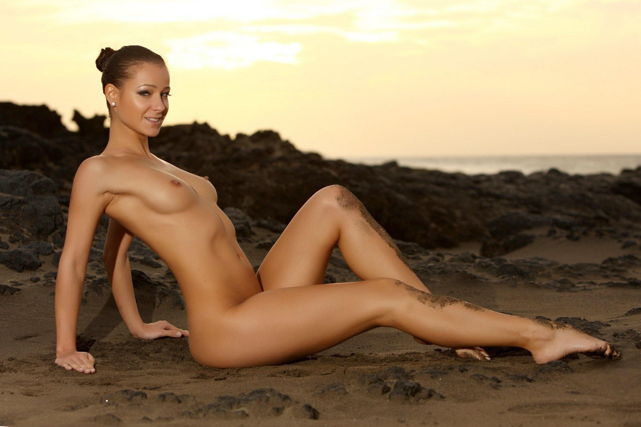 Naked women at sunset consider
