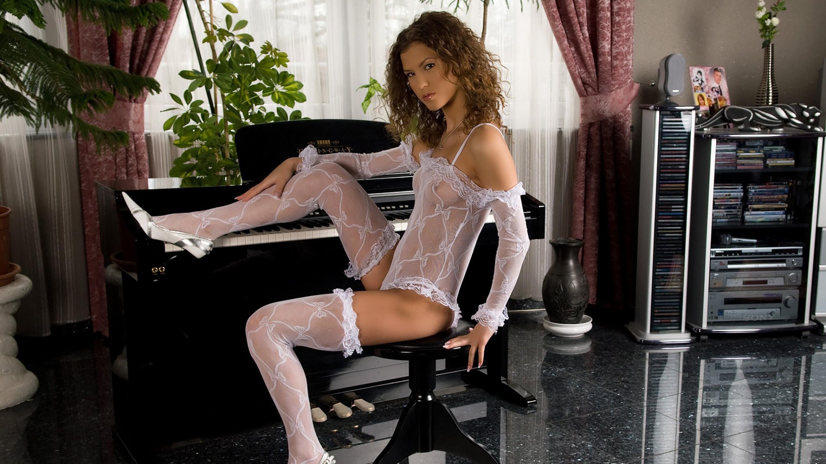 sexy girl playing piano