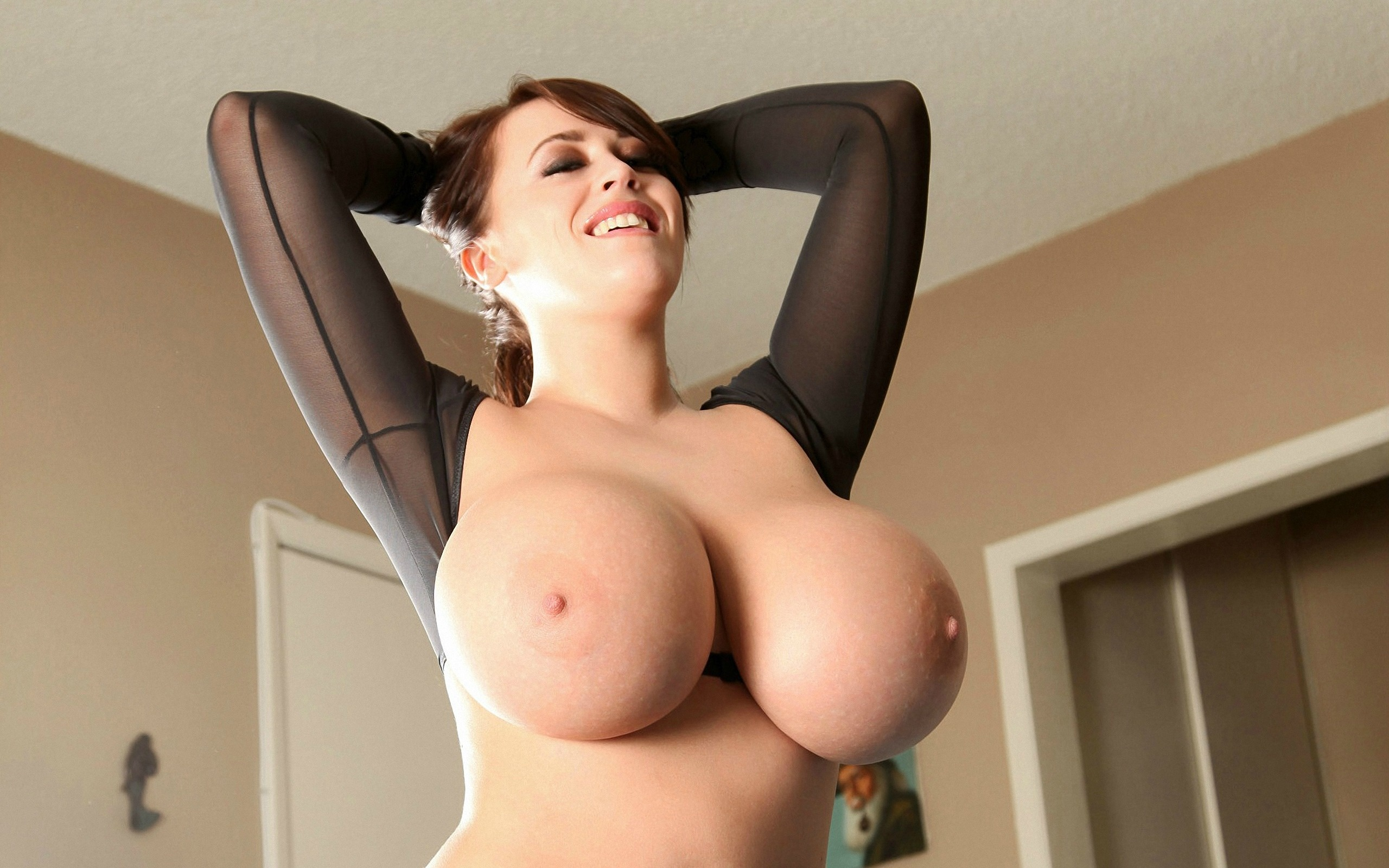 a very big breasted woman having sex
