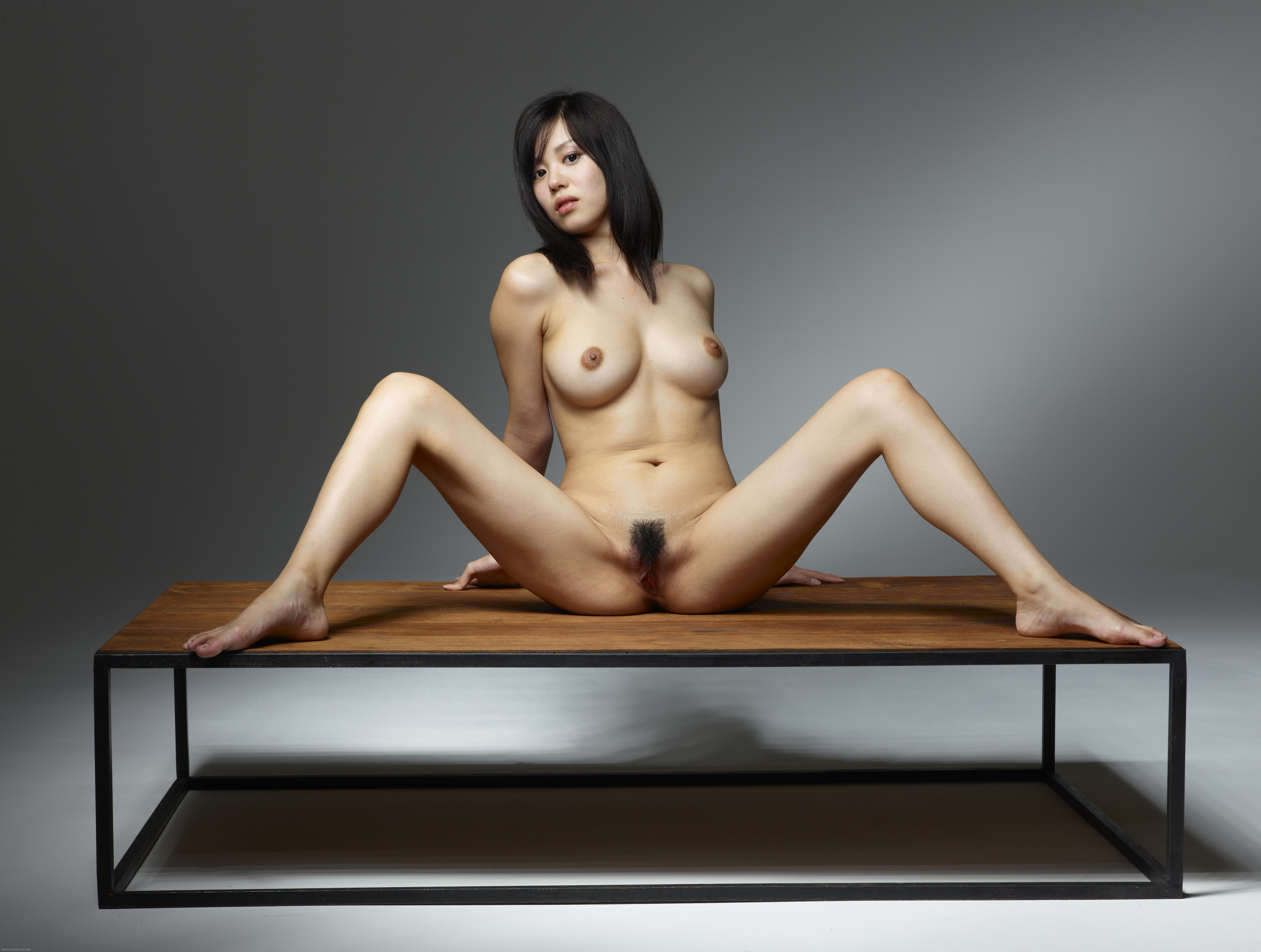 nude busty asian sitting down