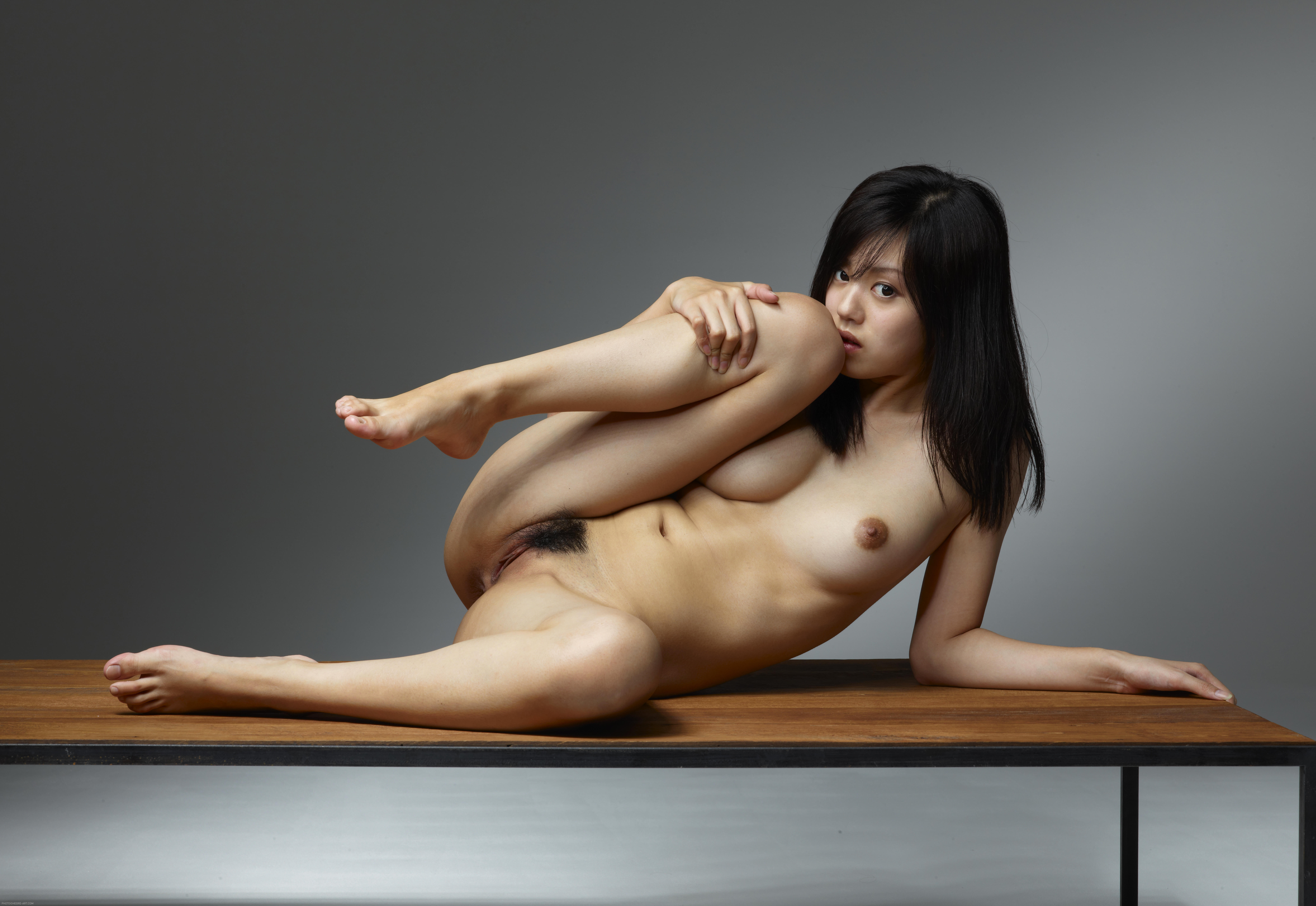 Asian on table nude
