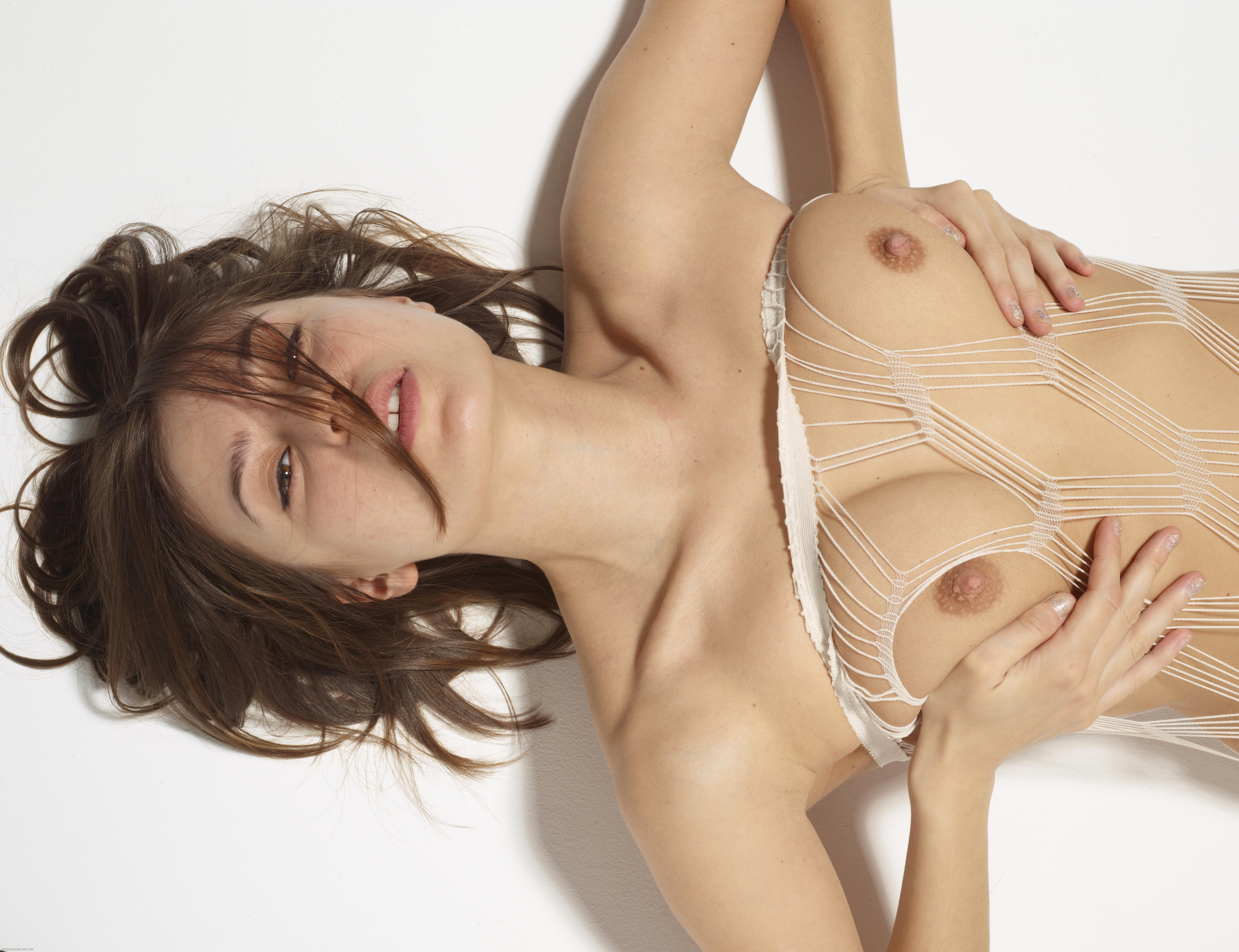 girl squeezing nude nipples up close