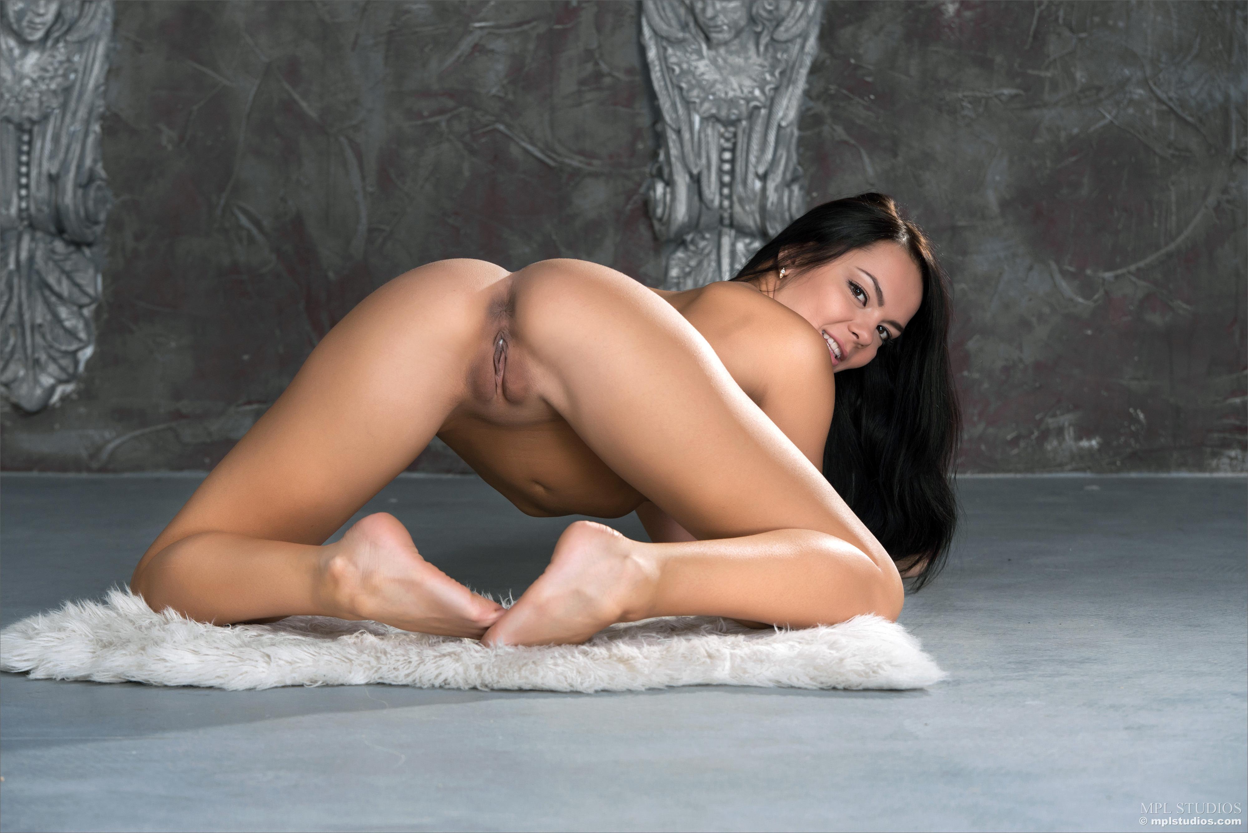 Nude woman wearing torn jean near pussy