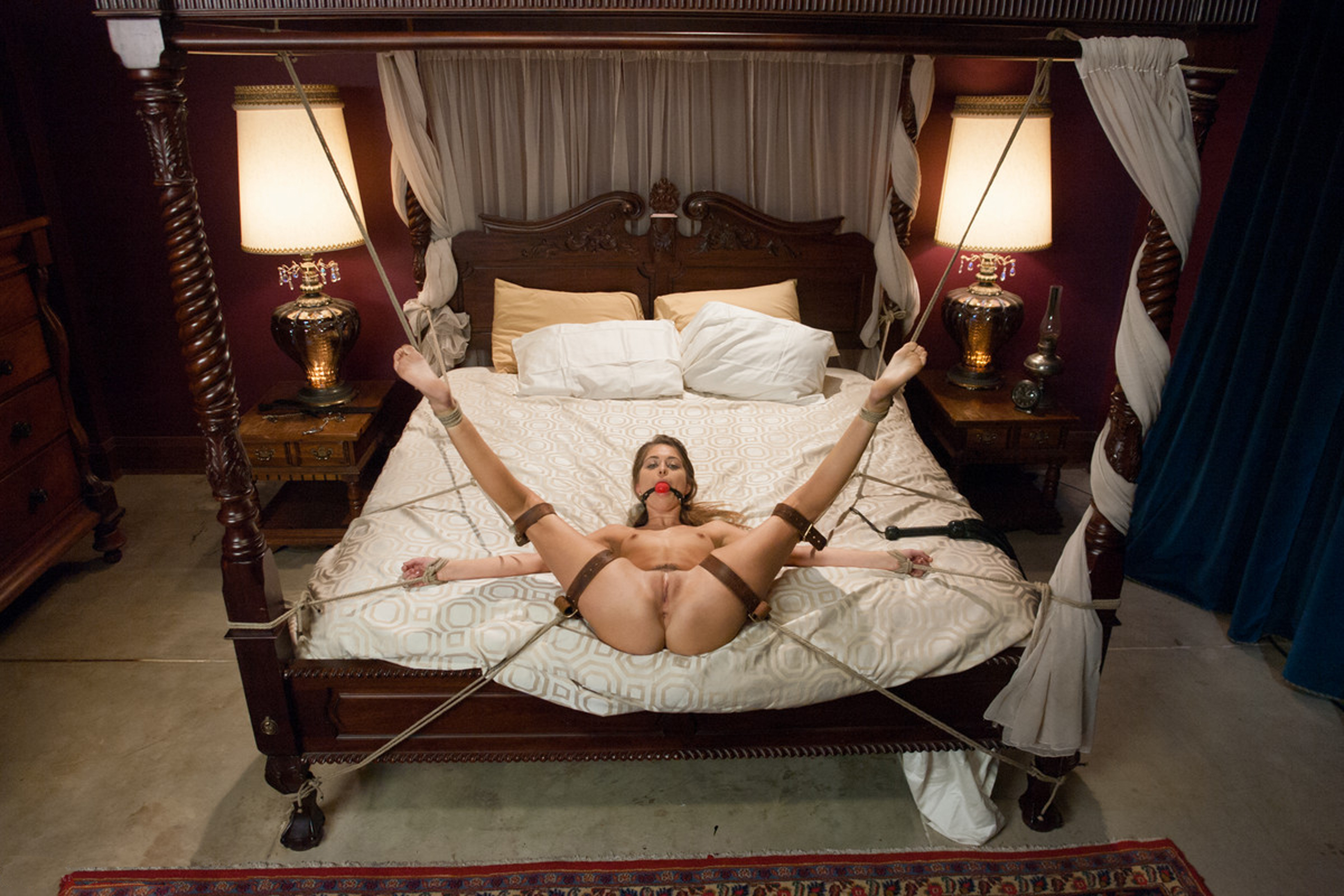 Naked girls tied to a bed-7975