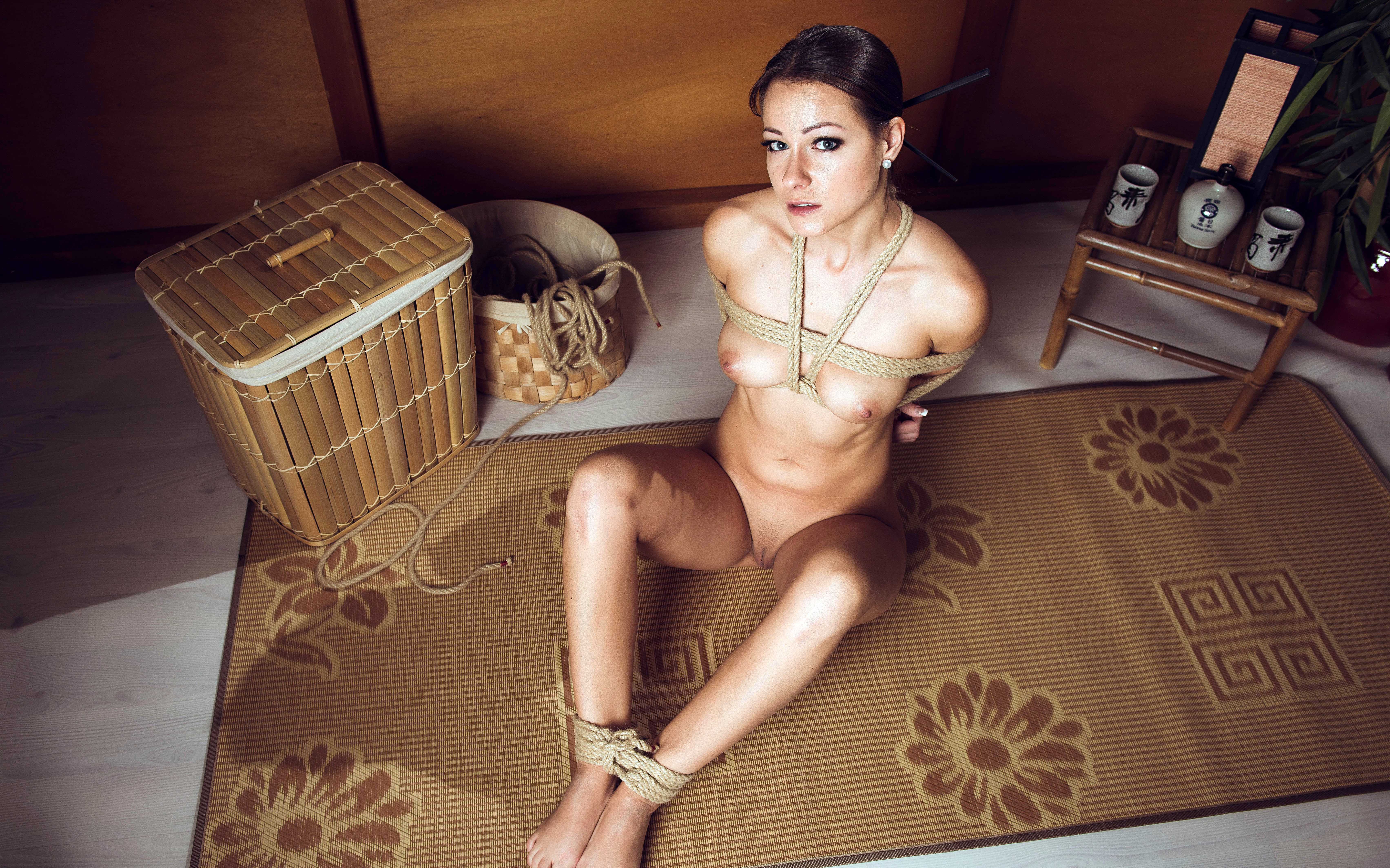 Brunette tied up rope bed