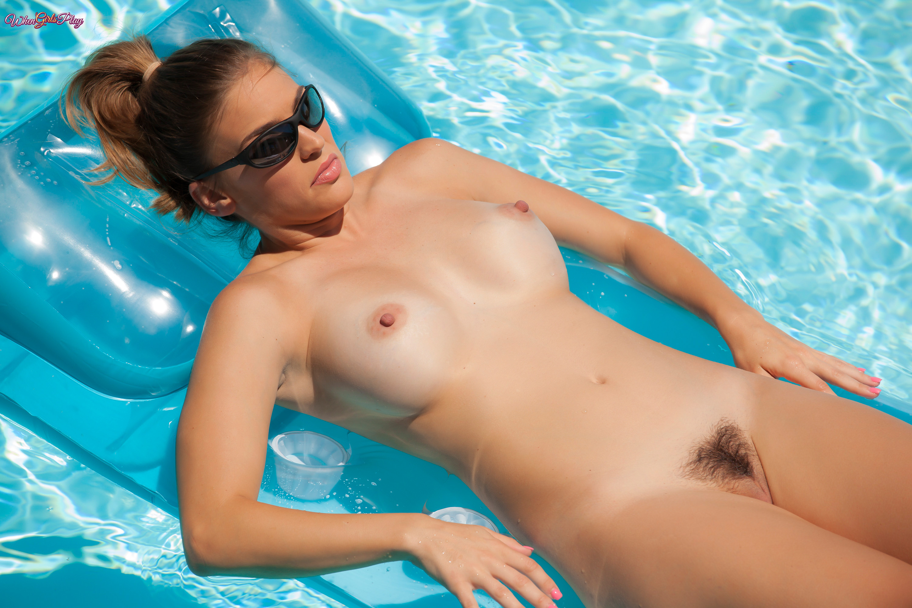 Naked girls are having some fun by the pool in