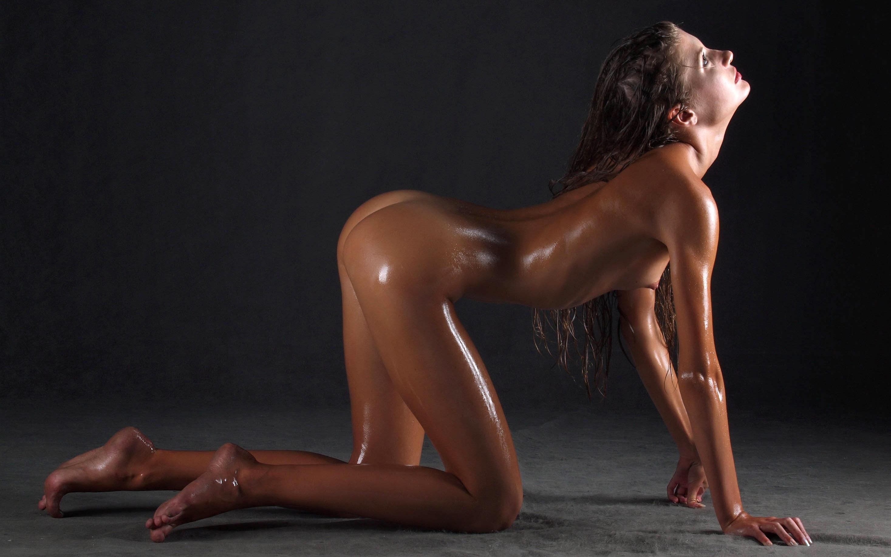 Sexy Oiled Female Body In Black Erotic Lingerie Stock Photo
