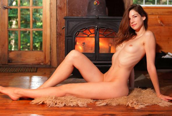 nude women by a fireplace