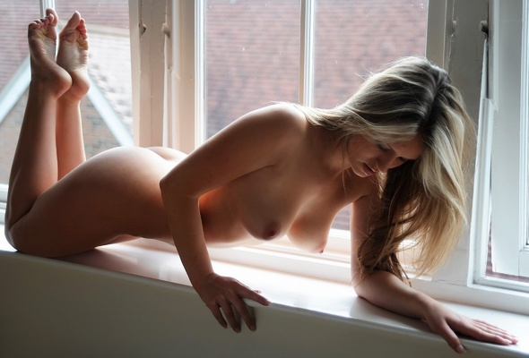 Nude girl in window