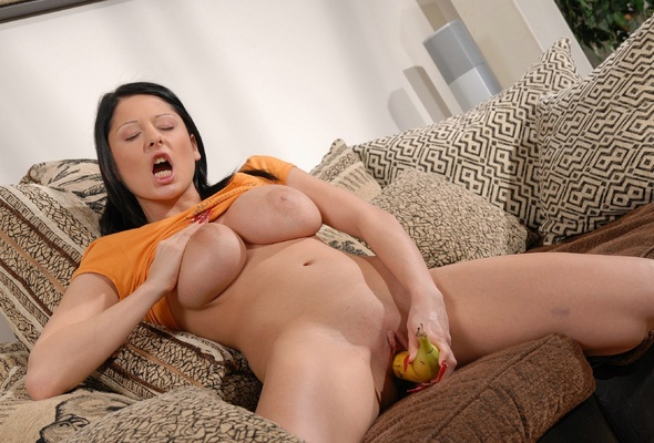 image Buxom brunette alison masturbates on the couch
