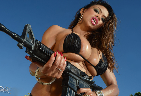 Busty Babes With Guns