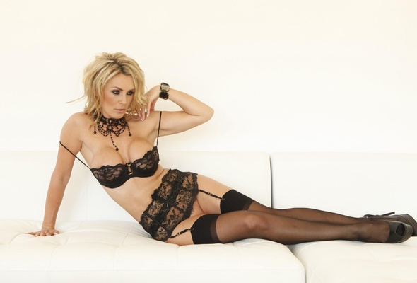 Sexy legs blonde milf poses in stockings
