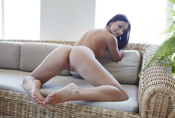Asian woman showering naked