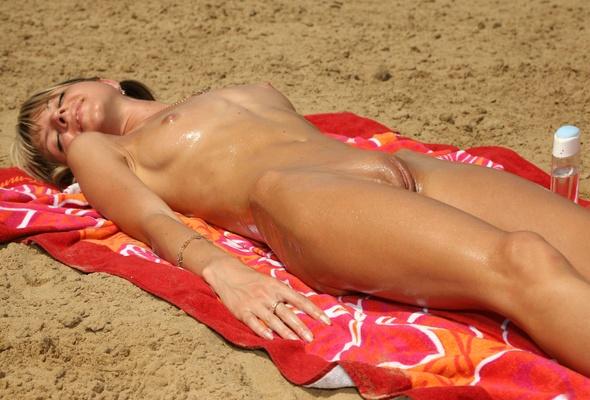 Nude sunbathing close up