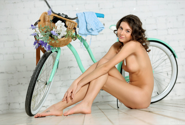 naked brunette on bicycling