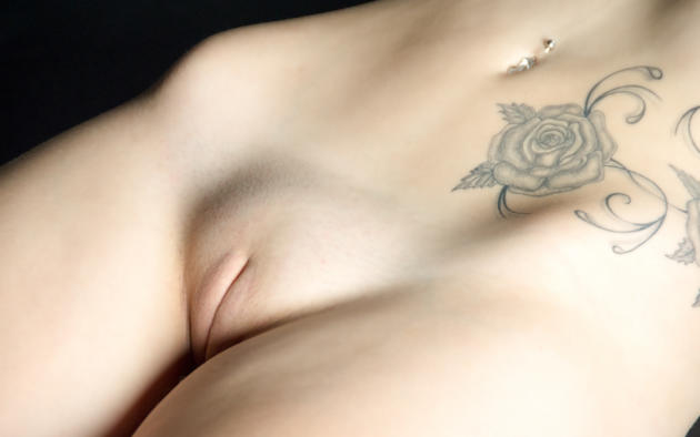 Girl naked with pussy tatoo