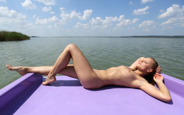 girl paddle boat on Naked