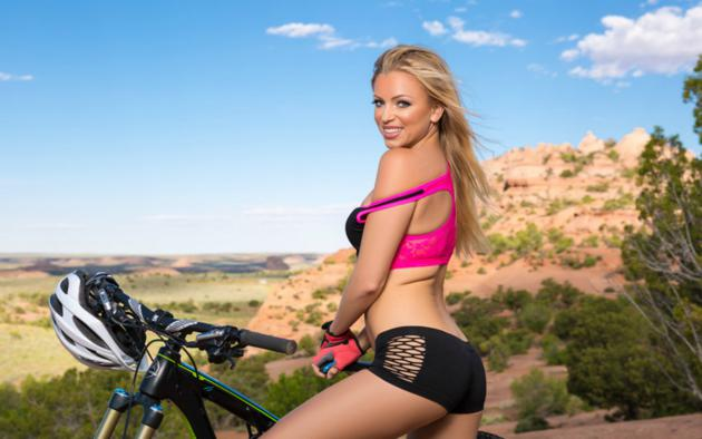 blanca brooke, blonde, model, black shorts, sports bra, bike, blue sky, gloves, playboy, dirt, outdoors, helmet, low quality