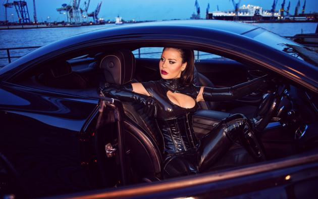 lady lana, german, brunette, mistress, tight clothes, latex, catsuit, underbust corset, hamburg, harbor, car, pvc, overknee boots, fetish babe, hot, decollete, red lips