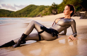 bianca beauchamp, latex, tomb rider, big, tits, redhead, outdoor, sea, water, wet, guns, sand, fantasy, rubber, fetishqueen, fetish, shiny, tomb raider, cosplay, tomb raider set, canadian, model, sexy babe, fetish babe, lara croft