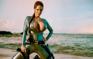 bianca beauchamp, canadian, model, redhead, sexy babe, fetishqueen, cosplay, lara croft, tomb raider, kneeling, pin up style, beach, sand, water, latex, catsuit, decollete, queue, pistols, rubber, fetish, tomb raider set, bianca, super boobs