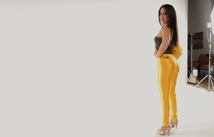 young, brunette, model, sexy dressed, posing, shiny, yellow, leggings, smile, heels, top, handbag, sexy ass, sexy babe, long hair, ass, legs, nice rack, tight clothes, high heels, sexy, ass wallpaper, shiny clothes, fetish babe