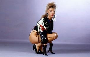 sandra shaw, brunette, pornactress, model, sexy babe, posing, kneeling, leather jacket, lingerie, thong, gloves, handbra, earrings, necklace, suze classics, sandra, heels, red lips, classic, retro, blue eyes, own cut