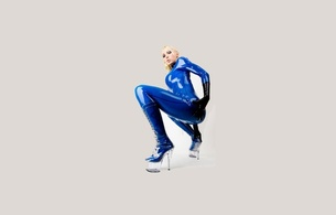 latex, blonde, sexy, heels, minimalist wall, susan wayland, blue, catsuit, fullsuit, gloves, shiny, rubber, fetish, plastic, plateau boots, tight clothes