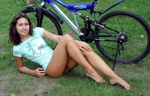 eva jane, brunette, sexy girl, adult model, bicycle, outdoors, t-shirt, beautiful female legs, view, look, velocipede, cosima