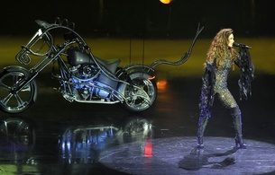 shania twain, american, celebrity, singer, songwriter, brunette, sexy babe, milf, long hair, performing, on stage, sexy, dressed, bodystocking, leather, knee boots, costum bike, real celebs wall, babes in boots