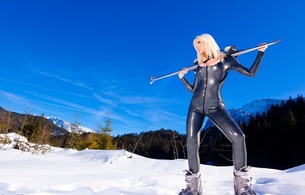 susan wayland, blonde, german, alternative, fetish supermodel, tattoo, busty, slim, sexy babe, long hair, posing, outdoor, silver, latex, catsuit, ski boots, heaven, clouds, blue sky, landscape, erotic, shiny, rubber, fetish, susan, snow