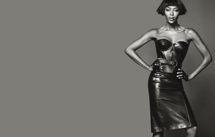 naomi campbell, british, exotic, supermodel, celebrity, actress, ebony, sexy babe, brunette, long hair, posing, smile, tight clothes, black, leather, corset, skirt, erotic, hi-q, minimalist wall, own cut, naomi, real celebs wall