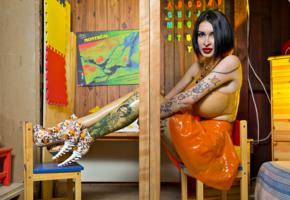 ariane saint, canadian, brunette, adult model, busty, sexy babe, tattoo, sitting, tight clothes, orange, latex, miniskirt, tattoos, body art, legs, ankle boots, shiny, rubber, fetish, fetish babe