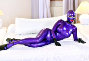 latex lucy, british, busty, glamour, fetish model, curvy, fake boobs, posing, laying, bed, purple, latex, catsuit, fullsuit, hood, shiny, rubber, fetish, gloves, plateau heels, erotic, fetish babe, red lips, hot body, lucy, rubber passion, rubberdoll