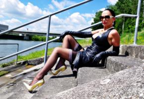 nadja, german, amateur, fetish model, real life, mistress, domina, fetish diva nadja, posing, outdoor, munich, shiny, leather, minidress, gloves, stockings, legs, golden, high heels, 21cm, fetish babe, tight clothes, sunglasses, relaxing