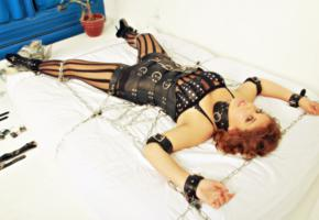 fetish, bed, mesh, bodystocking, leather, underbust corset, necktie, fixed, bondage gear, metal chains, tied, bdsm, fetish babe, ankle boots, slave, bondage, widescreen cut, ballet boots