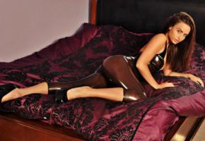 sarah arnold, brunette, british, bed, tight clothes, long legs, high heels, fetish babe, shiny, rubber, fetish