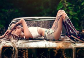 model, shorts, socks, tattoos, gym shoes, rusty car