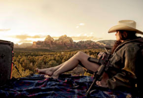 model, brunette, long hair, hat, jacket, legs, feet, pick up, rifle, gun machine, mountains, landscape, no nude