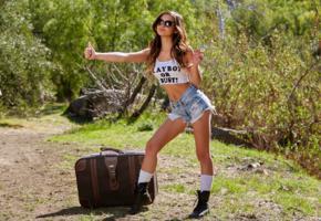 alex de la flor, sexy girl, adult model, chica, outdoor, brunette, sunglasses, jeans shorts, suitcase