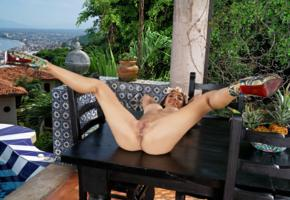 frida sante, brunette, outdoors, table, naked, big tits, nipples, shaved pussy, labia, ass, anus, spread legs, high heels, smile, hi-q