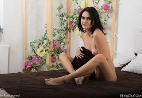 stella p, sitting, bed, tits, nude, tanned, black hair, pillow
