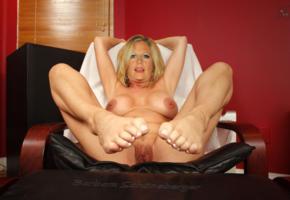 barbara schoneberger, blonde, big boobs, legs spread, pussy, labia, feet, posing, relax, on chair, fake