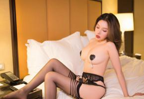huang le ran, asian, sexy, lingerie, stockings, bed, pillows, black stockings, suspenders, brunette, boobs, tits, nipples pasties, nipple pasties, pasties