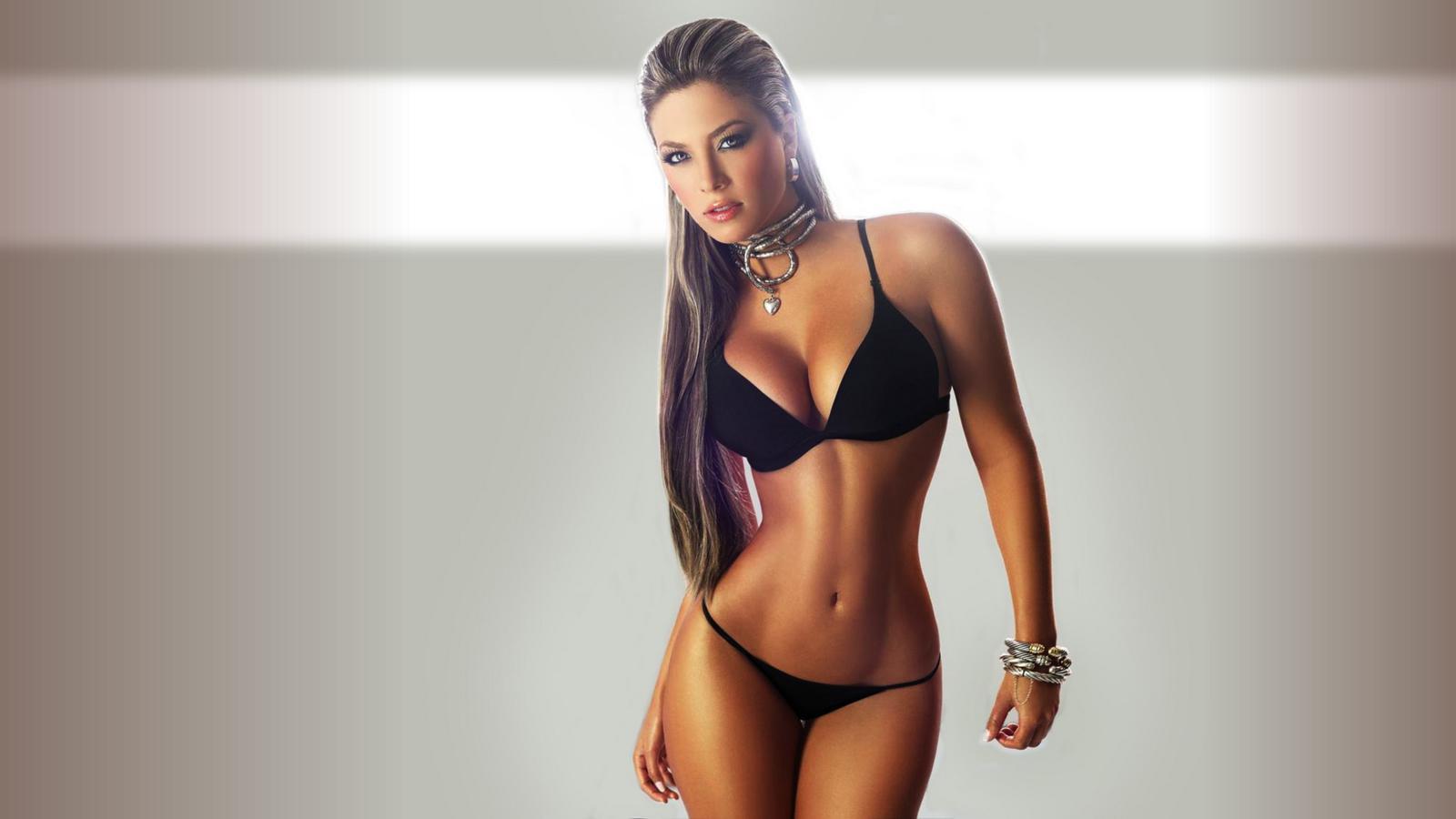 image Sexy babe in bikini licks pussy